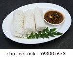 Small photo of Noolappam/Idiyappam/rice noodles, a popular traditional steam cooked Kerala breakfast dish with hot spicy black bengal gram curry on houseboat, Alleppey, India. South Indian food. noolputtu Sri lankan