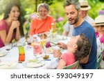 three generations family having ... | Shutterstock . vector #593049197