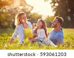 family with children blow soap... | Shutterstock . vector #593061203