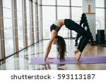 girl practicing yoga at the gym