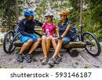 family bike rides in the... | Shutterstock . vector #593146187