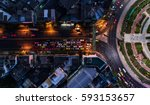 road roundabout with car lots... | Shutterstock . vector #593153657