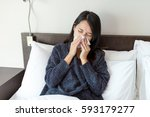 woman feeling sick and sneeze... | Shutterstock . vector #593179277