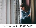 young sad woman sitting on the... | Shutterstock . vector #593195693
