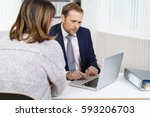 businessman in suit working... | Shutterstock . vector #593206703