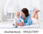 happy young mother and adorable ... | Shutterstock . vector #593227397