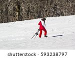 woman skiing on the slopes | Shutterstock . vector #593238797