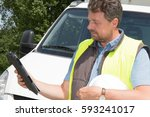 deliverer with his tablet in...   Shutterstock . vector #593241017