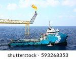 supply boat transfer cargo to... | Shutterstock . vector #593268353