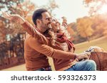 happy young couple going for a... | Shutterstock . vector #593326373