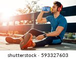 portrait of young man drinking... | Shutterstock . vector #593327603