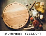 pizza cutting board at table... | Shutterstock . vector #593327747