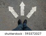 arrow on asphalt leg top view...   Shutterstock . vector #593372027