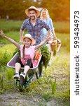 very cheerful daughter in... | Shutterstock . vector #593434973