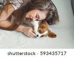 the girl with the puppy close... | Shutterstock . vector #593435717