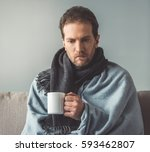 handsome sick man is holding a... | Shutterstock . vector #593462807
