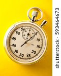 stopwatch on yellow background... | Shutterstock . vector #593464673
