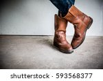 Legs Of Man Wearing Boots...