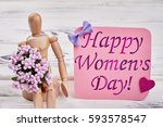 wooden man  flowers and card.... | Shutterstock . vector #593578547