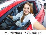 car selfie. happy beautiful... | Shutterstock . vector #593600117