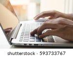 man hand working on laptop... | Shutterstock . vector #593733767