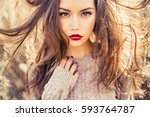 outdoor fashion photo of young... | Shutterstock . vector #593764787