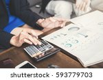 businesswoman calculating and... | Shutterstock . vector #593779703