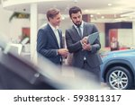 manager and customer in showroom | Shutterstock . vector #593811317