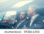 two businessmen in car | Shutterstock . vector #593811353