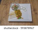 pork satay grilled pork served... | Shutterstock . vector #593878967