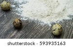 Small photo of quail and thicken egg in the flour on a wooden surface