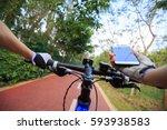 cyclist hands use gps navigator ... | Shutterstock . vector #593938583