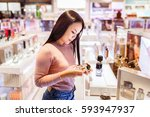 young asian woman applying and... | Shutterstock . vector #593947937