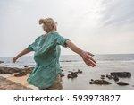 free woman enjoying windy... | Shutterstock . vector #593973827