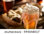 amber beer with overflowing... | Shutterstock . vector #594048017