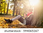 the girl in the park leaning on ... | Shutterstock . vector #594065267