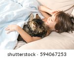 child sleeping with cat at home | Shutterstock . vector #594067253