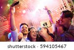 cheerful friends partying in... | Shutterstock . vector #594105467