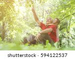 grandfather pointing with... | Shutterstock . vector #594122537