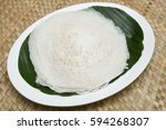 Small photo of Appam / Palappam / plain hoppers made of white rice powder, a popular traditional Kerala breakfast bread with spicy Bengal gram lentils curry houseboat, Alappuzha Alleppey, India. South Indian food.