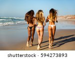 three beautiful girls running... | Shutterstock . vector #594273893