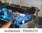 worker welding the sheet metal... | Shutterstock . vector #594281273