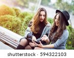 portrait of two beautiful young ... | Shutterstock . vector #594322103