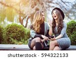 portrait of two beautiful young ... | Shutterstock . vector #594322133
