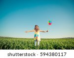 happy child outdoors against... | Shutterstock . vector #594380117