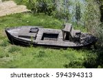 old boat left on the shore in... | Shutterstock . vector #594394313