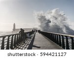 backwash on the great jetty of... | Shutterstock . vector #594421127