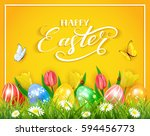 easter eggs in grass on yellow... | Shutterstock .eps vector #594456773