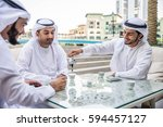 three arabic men bonding... | Shutterstock . vector #594457127