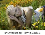 beautiful blond woman in a... | Shutterstock . vector #594523013
